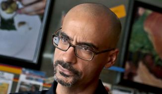 "In this Sept. 3, 2013 photo, Pulitzer Prize winning author Junot Diaz pauses during an interview in New York. Three editors at the Boston Review are resigning over the political and literary magazine's decision to retain Diaz despite allegations of sexual misconduct. Poetry editors Timothy Donnelly, Barbara Fischer and Stefania Heim said on Twitter last week they're ""dismayed"" at the logic behind keeping Diaz as fiction editor and felt compelled to step down, effective July 1. (AP Photo/Bebeto Matthews, File)"