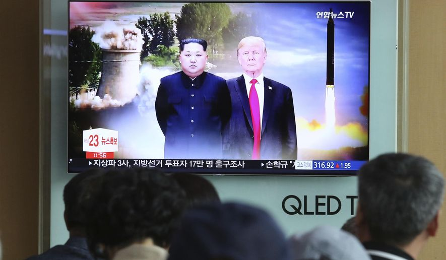 People watch a TV screen showing file footage of U.S. President Donald Trump, right, and North Korean leader Kim Jong Un during a news program at Seoul Railway Station in Seoul, South Korea, Monday, June 11, 2018.  Final preparations are underway in Singapore for Tuesday's historic summit between President Trump and North Korean leader Kim, including a plan for the leaders to kick things off by meeting with only their translators present, a U.S. official said. (AP Photo/Ahn Young-joon)