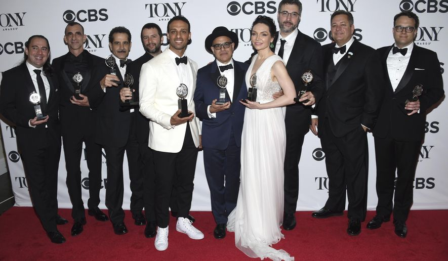 "Cast and crew of ""The Band's Visit"" pose in the press room with the award for best musical at the 72nd annual Tony Awards at Radio City Music Hall on Sunday, June 10, 2018, in New York. (Photo by Evan Agostini/Invision/AP)"