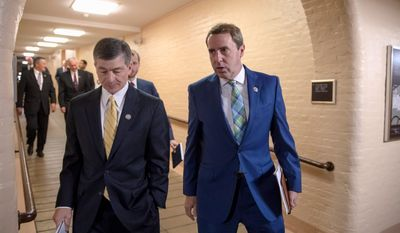 """We don't have a deal at this point,"" said Rep. Mark Walker, North Carolina Republican (right). ""We're at the midnight hour,"" he said as he emerged from negotiations in House Speaker Paul D. Ryan's office. Mr. Walker is one of the conservative leaders on the immigration issue. Rep. Jeb Hensarling, R-Texas, left, and Rep. Mark Walker, R-N.C., as House Republicans try to bridge their party's internal struggle over immigration at a closed-door meeting on Capitol Hill in Washington, Thursday, June 7, 2018. Rep. Walker says a large group of conservatives he leads has discussed providing a pathway to citizenship to ""Dreamers"" in exchange for funding for the proposed border wall, ending the visa lottery and limiting the relatives immigrants can bring into the country. (AP Photo/J. Scott Applewhite) (Associated Press)"
