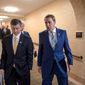"""""""We don't have a deal at this point,"""" said Rep. Mark Walker, North Carolina Republican (right). """"We're at the midnight hour,"""" he said as he emerged from negotiations in House Speaker Paul D. Ryan's office. Mr. Walker is one of the conservative leaders on the immigration issue. Rep. Jeb Hensarling, R-Texas, left, and Rep. Mark Walker, R-N.C., as House Republicans try to bridge their party's internal struggle over immigration at a closed-door meeting on Capitol Hill in Washington, Thursday, June 7, 2018. Rep. Walker says a large group of conservatives he leads has discussed providing a pathway to citizenship to """"Dreamers"""" in exchange for funding for the proposed border wall, ending the visa lottery and limiting the relatives immigrants can bring into the country. (AP Photo/J. Scott Applewhite) (Associated Press)"""