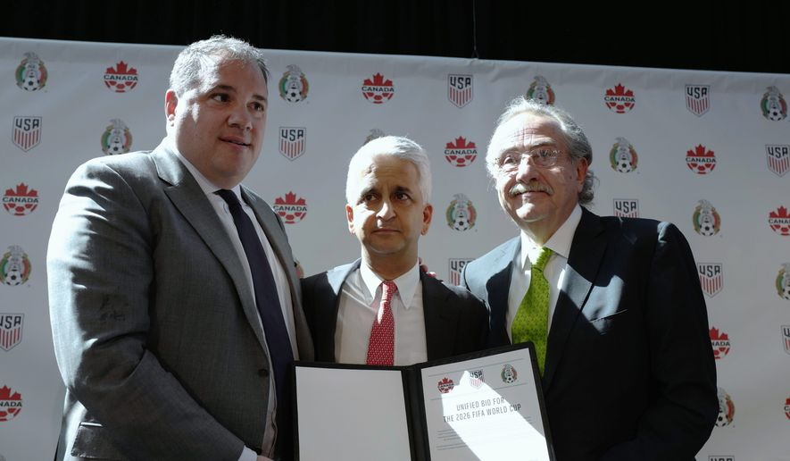 Soccer officials (from left) Victor Montagliani of Canada, Sunil Gulati of the United States, and Decio de Maria of Mexico find out Wednesday if their unified bid to co-host the 2026 World Cup will be accepted by FIFA. (Associated Press)