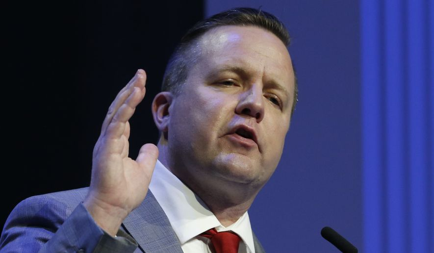Republican primary senatorial candidate Corey Stewart gestures during a debate with E. W. Jackson and Del. Nick Freitas at Liberty University in Lynchburg, Va., Thursday, April 19, 2018. (AP Photo/Steve Helber) ** FILE **
