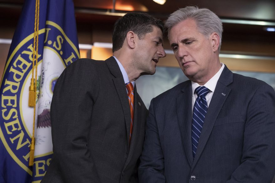 Speaker of the House Paul Ryan, R-Wis., left, confers with House Majority Leader Kevin McCarthy, R-Calif., during a news conference on Capitol Hill in Washington, Wednesday, May 16, 2018. The GOP leadership praised the work of the Agriculture Committee in crafting the farm bill which the House begins debate on today. (AP Photo/J. Scott Applewhite)