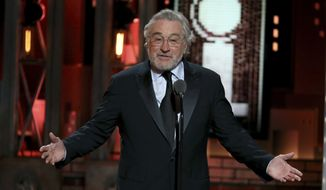Robert De Niro gestures while introducing a performance by Bruce Springsteen at the 72nd annual Tony Awards at Radio City Music Hall on Sunday, June 10, 2018, in New York. (Photo by Michael Zorn/Invision/AP) ** FILE **