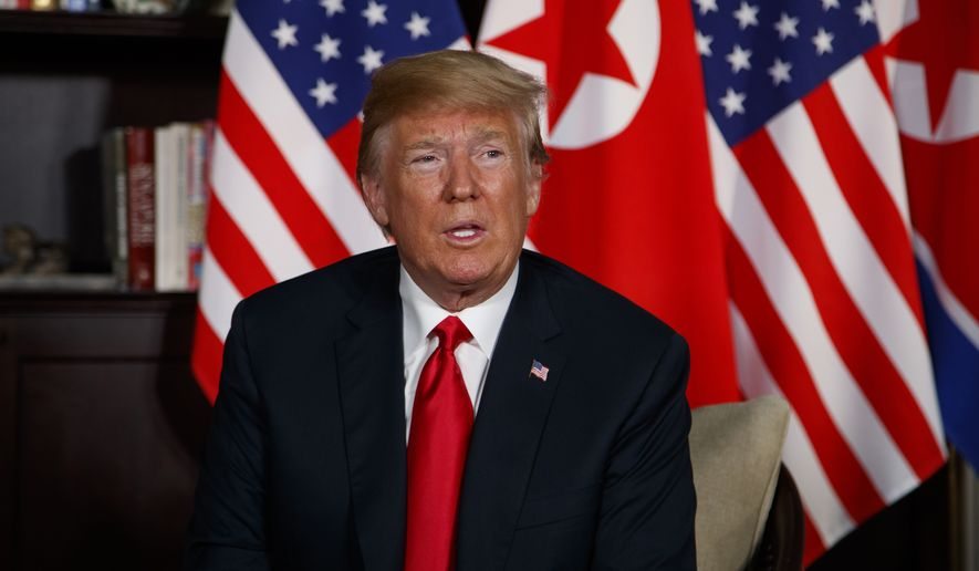 President Donald Trump listens during a meeting with North Korean leader Kim Jong Un on Sentosa Island, Tuesday, June 12, 2018, in Singapore. (AP Photo/Evan Vucci)