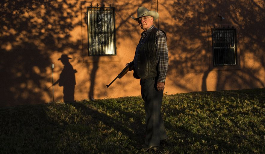 File - In this Sunday, April 2, 2017 file photo, rancher Jim Chilton poses for a photo on his ranch in Arivaca, about 80 miles southwest of Tucson, Ariz. A U.S. Border Patrol agent was wounded in a shooting on a southern Arizona ranch near the U.S.-Mexico border before dawn Tuesday, June 12, 2018, in a remote area known for drug and migrant smuggling, the agency and the cattleman who owns the property said. Chilton, a fifth-generation Arizona cattleman who runs a 50,000-acre (about 20,230-hectare) ranch outside Arivaca, told The Associated Press in an interview that the Border Patrol sent him an email saying the agent was alone when he was wounded on the ranch and was struck in the leg and the hand. (AP Photo/Rodrigo Abd, File)