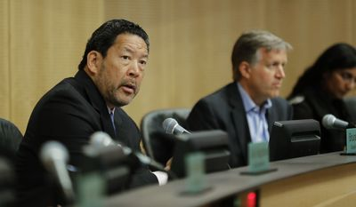 Seattle City Council president Bruce Harrell, left, speaks, Tuesday, June 12, 2018, during a council meeting at City Hall in Seattle. Harrell and other members of the Council were expected to vote Tuesday on whether or not to repeal a tax on large companies such as Amazon and Starbucks that was intended to combat a growing homelessness crisis. (AP Photo/Ted S. Warren)