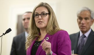 State Sen. Jennifer Wexton, D-Loudoun, gestures during a news conference by the Senate Democratic caucus at the Capitol in Richmond, Va., Thursday, Jan. 14, 2016. (AP Photo/Steve Helber) ** FILE **