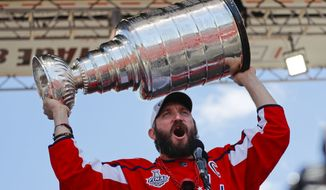 Washington Capitals forward Alex Ovechkin (8), of Russia, holds up the Stanley Cup for fans to see during the NHL hockey team's Stanley Cup victory celebration at the National Mall in Washington, Tuesday, June 12, 2018. (AP Photo/Pablo Martinez Monsivais) ** FILE **