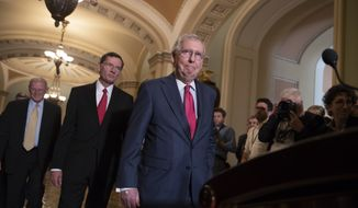 Senate Majority Leader Mitch McConnell, R-Ky., joined by Sen. James Inhofe, R-Okla., a member of the Senate Armed Services Committee, far left, and Sen. John Barrasso, R-Wyo., second from left, arrives for a news conference on Capitol Hill in Washington, Tuesday, June 12, 2018. Republican and Democratic leaders aren't quite celebrating President Donald Trump's historic meeting Tuesday with North Korea's Kim Jong Un, saying the initial agreement they struck won't mean much unless the North completely denuclearizes. (AP Photo/J. Scott Applewhite) **FILE**