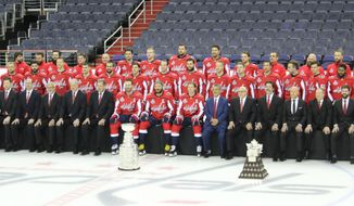 The 2018 Washington Capitals pose for their official team photo with the Stanley Cup (center) at Capital One Arena on Tuesday, June 12, 2018. (Photo by Adam Zielonka / The Washington Times)