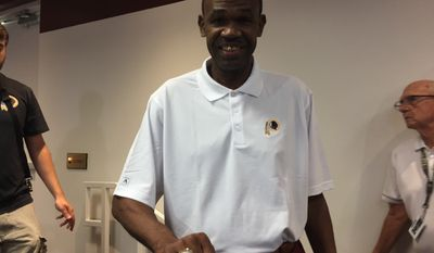 Charles Jackson, a replacement player on the 1987 Redskins, shows off the Super Bowl ring he received Tuesday at Redskins Park. (Andy Kostka photo)