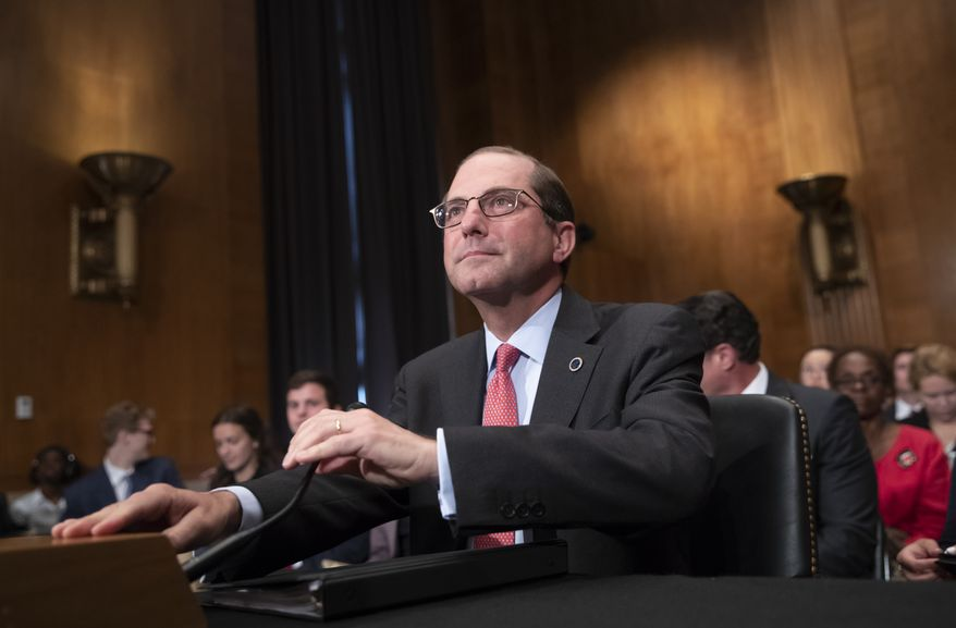 Secretary of Health and Human Services Alex Azar prepares to testify before the Senate Health, Education, Labor, and Pensions Committee at a hearing on prescription drug prices, on Capitol Hill in Washington, Tuesday, June 12, 2018. Before joining the Trump Cabinet, Azar was president of the U.S. division of Eli Lilly and Company, a major pharmaceutical drug company. (AP Photo/J. Scott Applewhite)