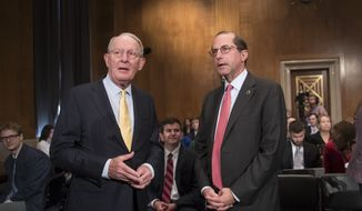 Sen. Lamar Alexander, R-Tenn., left, chairman of the Senate Health, Education, Labor, and Pensions Committee, greets Secretary of Health and Human Services Alex Azar the witness at a hearing on prescription drug prices, on Capitol Hill in Washington, Tuesday, June 12, 2018. Before joining the Trump Cabinet, Azar was president of the U.S. division of Eli Lilly and Company, a major pharmaceutical drug company. (AP Photo/J. Scott Applewhite)