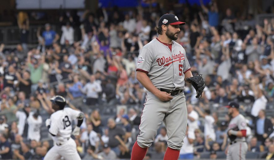 Washington Nationals pitcher Tanner Roark (57) waits as New York Yankees' Didi Gregorius (18) rounds the bases with a home run during the second inning of a baseball game Tuesday, June 12, 2018, at Yankee Stadium in New York. (AP Photo/Bill Kostroun)