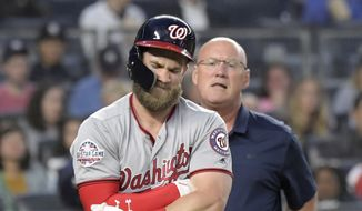 Washington Nationals' Bryce Harper reacts after being hit by a pitch by New York Yankees pitcher CC Sabathia (not shown) during the fifth inning of a baseball game Tuesday, June 12, 2018, at Yankee Stadium in New York. Harper stayed in the game. (AP Photo/Bill Kostroun) **FILE**