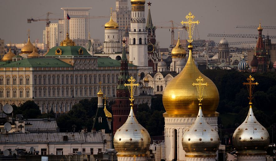The setting sun is reflected in church towers reflect in central Moscow, Russia, Tuesday, June 12, 2018. The World Cup 2018 starts on Thursday. (AP Photo/Michael Probst)