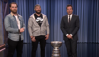 "Braden Holtby (left) and Alex Ovechkin (center) of the Washington Capitals appear with the Stanley Cup on ""The Tonight Show"" with host Jimmy Fallon (right) on Monday, June 11, 2018. (Video screenshot via YouTube / ""The Tonight Show Starring Jimmy Fallon"")"