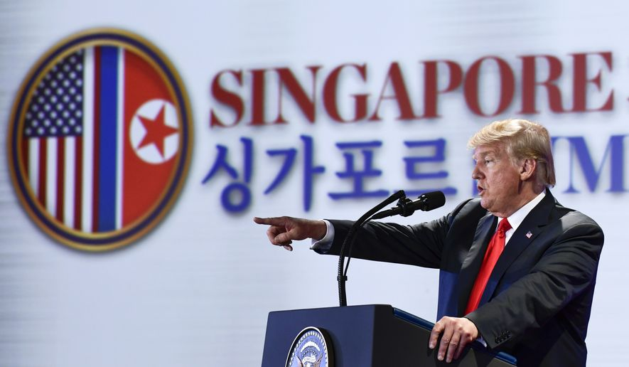 U.S. President Donald Trump answers questions about the summit with North Korea leader Kim Jong-un during a press conference at the Capella resort on Sentosa Island Tuesday, June 12, 2018 in Singapore. (AP Photo/Susan Walsh)
