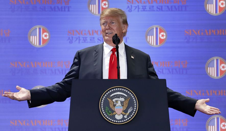 U.S. President Donald Trump answers questions about the summit with North Korea leader Kim Jong Un during a press conference at the Capella resort on Sentosa Island Tuesday, June 12, 2018 in Singapore. (AP Photo/Evan Vucci)