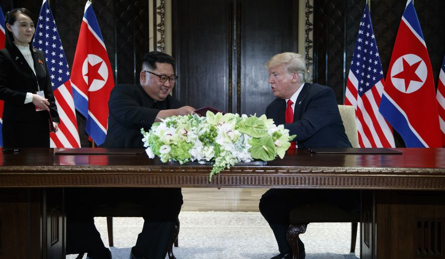 President Donald Trump and North Korean leader Kim Jong Un participate in a signing ceremony during a meeting on Sentosa Island, Tuesday, June 12, 2018, in Singapore. (AP Photo/Evan Vucci)