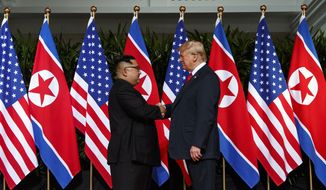 North Korean leader Kim Jong-un, left, and U.S. President Donald Trump shake hands prior to their meeting on Sentosa Island in Singapore Tuesday, June 12, 2018. (AP Photo/Evan Vucci)
