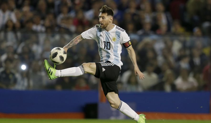 FILE - In this May 29, 2018, file photo, Argentina's Lionel Messi controls the ball during a friendly soccer match between Argentina and Haiti at the Bombonera stadium in Buenos Aires, Argentina. Lionel Messi and Cristiano Ronaldo have split the last 10 FIFA Player of the Year awards, and this is likely their last chance to win a World Cup. (AP Photo/Natacha Pisarenko, File) **FILE**