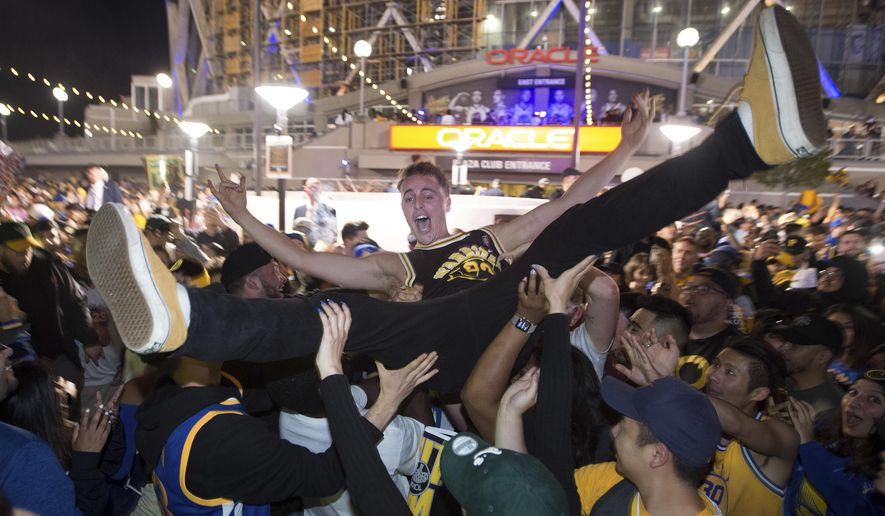 Ben Del Fante crowd-surfs as Golden State Warriors fans celebrate outside Oracle Arena in Oakland, Calif., Friday, June 8, 2018. The Warriors defeated the Cleveland Cavaliers 108-85 in Game 4 of the NBA Finals in Cleveland. (AP Photo/Josh Edelson)