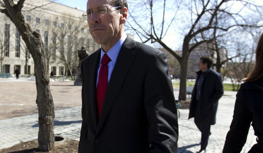 FILE- In this March 22, 2018, file photo, AT&T CEO Randall Stephenson leaves the federal courthouse in Washington. The judge presiding over the government's legal effort to block AT&T's purchase of Time Warner will likely deliver his verdict on Tuesday, June 12. (AP Photo/Jose Luis Magana, File)