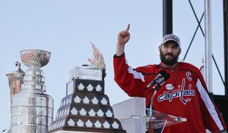 Washington Capitals forward Alex Ovechkin (8), of Russia, gestures while speaking during the Stanley Cup victory celebration on the National Mall in Washington, Tuesday, June 12, 2018. (AP Photo/Pablo Martinez Monsivais)
