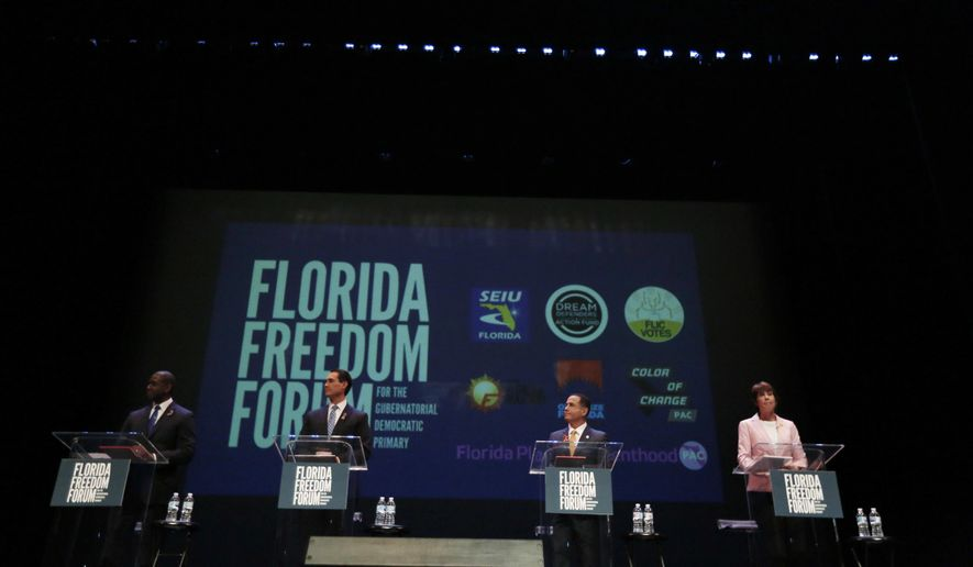 Businessman Chris King, left to right, Tallahassee Mayor Andrew Gillum,  Miami Beach Mayor Philip Levine, and U.S. Rep. Gwen Graham, listen to the moderators during a gubernatorial debate ahead of the Democratic primary for governor on Monday, June 11, 2018, in Miramar, Fla. (AP Photo/Brynn Anderson, Pool)