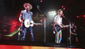 FILE - In this June 10, 2018 file photo, Brian Kelley, left, and Tyler Hubbard of Florida Georgia Line perform at the 2018 CMA Music Festival in Nashville, Tenn. (Photo by Laura Roberts/Invision/AP, File)