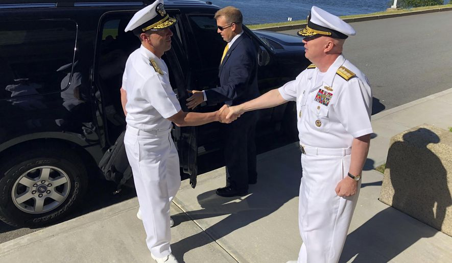 Adm. John Richardson, left, chief of naval operations, greets Rear Adm. Jeffrey Harley, president of the U.S. Naval War College, Tuesday, June 12, 2018, in Newport, R.I. U.S. Navy leaders are in Rhode Island to strategize with scholars about how technology and innovation will affect the nation's security. (AP Photo/Jennifer McDermott)