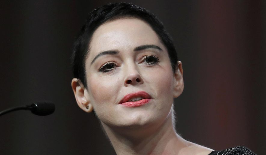 FILE- In this Oct. 27, 2017, file photo, actress Rose McGowan speaks at the inaugural Women's Convention in Detroit. A grand jury in Virginia has indicted the actress on one felony count of cocaine possession. McGowan's trial date will be set Tuesday. (AP Photo/Paul Sancya, File)