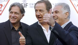 FILE - In this May 9, 2002 file photo, Guess Inc. founders and brothers, from left, Armand, Paul and Maurice Marciano arrive at the company's 20th anniversary party in Los Angeles. Guess Inc. says its co-founder Paul Marciano is stepping down after a company-commissioned investigation of allegations of sexual harassment and assault. The company announced in a filing Tuesday, June 12, 2018, with the Securities and Exchange Commission that Marciano is resigning immediately as executive chairman of the Guess board, and his brother and co-founder Maurice Marciano will take over.  (AP Photo/Chris Pizzello, File)