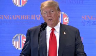 In this image made from video provided by Host Broadcaster Mediacorp Pte Ltd., U.S. President Donald Trump speaks during a press conference, following his meeting with North Korean leader Kim Jong Un at Capella Hotel in Singapore, Tuesday, June 12, 2018. (Host Broadcaster Mediacorp Pte Ltd via AP)