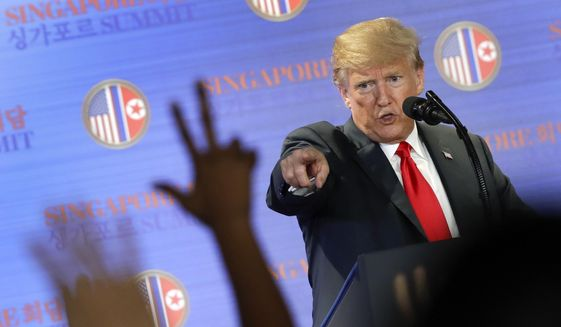 U.S. President Donald Trump answers questions about the summit with North Korea leader Kim Jong-un during a press conference at the Capella resort on Sentosa Island Tuesday, June 12, 2018 in Singapore. (AP Photo/Wong Maye-E) ** FILE **