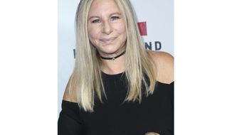 """FILE - In this Sept. 12, 2017 file photo, Barbra Streisand attends the Hand in Hand: A Benefit for Hurricane Harvey Relief in Universal City, Calif.  Streisand is giving an early thumbs-up to the remake of """"A Star Is Born"""" with Lady Gaga and Bradley Cooper. Streisand and Kris Kristofferson topped the 1976 version of the romantic drama about a rising performer and a fading star. (Photo by John Salangsang/Invision/AP, File)"""