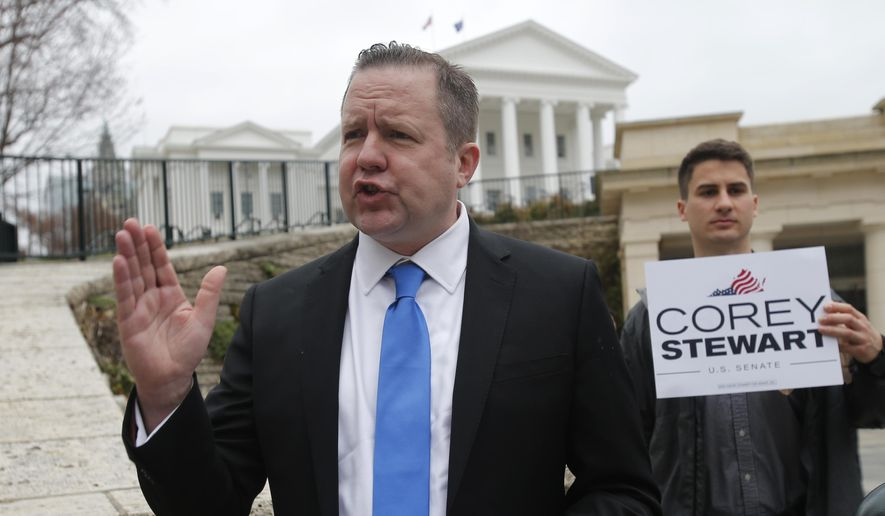 "In this Feb. 22, 2018, file photo, Virginia GOP senatorial hopeful, Corey Stewart, gestures during a news conference at the Capitol in Richmond, Va. Stewart, a conservative provocateur and supporter of President Donald Trump won Virginia's Republican primary Tuesday, June 12, 2018, in the U.S. Senate race, and he has promised to run a ""vicious"" campaign against incumbent Tim Kaine. (AP Photo/Steve Helber, File)"