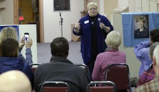 FILE - In this April 14, 2018, file photo, Wisconsin assembly candidate Ann Groves Lloyd speaks at an event at the offices of Columbia County Democratic Party in Portage, Wis. Lloyd faces Republican Jon Plumer in a special election in south-central Wisconsin's 42nd Assembly District. (AP Photo/Morry Gash, File)