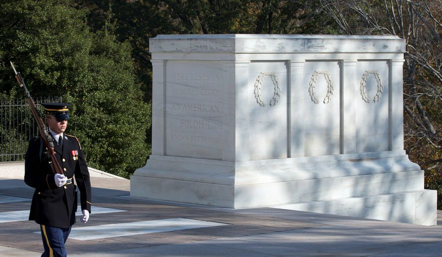 A member of the Old Guard guards the Tomb of the Unknowns at the Arlington National Cemetery in Arlington, Virginia. (Associated Press)