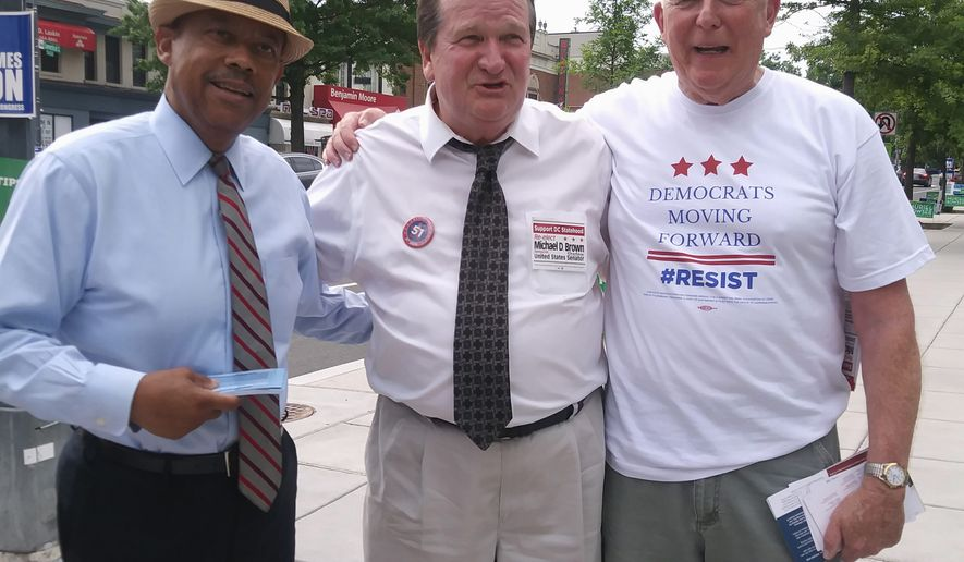 "L-R: Virgil J. Young (James Butler campaign aide), D.C. ""shadow"" senator Michael D. Brown and Dave Donaldson (at-large committeeman for Democratic State Committee candidate) enticing D.C. residents to cast early votes at the Chevy Chase Community Center. June 8, 2018 (Jada Butler/The Washington Times)"