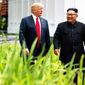 President Donald Trump walks with North Korean leader Kim Jong Un on Sentosa Island, Tuesday, June 12, 2018, in Singapore. (AP Photo/Evan Vucci)