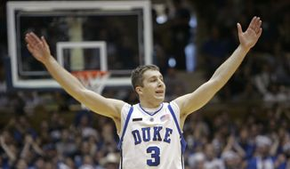 Duke's Greg Paulus reacts during the first half of a college basketball game against Boston College in Durham, N.C., Saturday, Feb. 9, 2008. (AP Photo/Gerry Broome) **FILE**