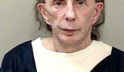 Music producer Phil Spector was sentenced to 19 years to life behind bars on second-degree murder charges. This Oct. 28, 2013 mugshot provided by the California Department of Corrections and Rehabilitation shows rock 'n' roll music producer Phil Spector, mostly bald with just a bit of hair, and completely free of the huge hair that was so striking during his murder trial. In a June 2017 mugshot the 76-year-old music producer is smiling broadly, completely bald and wearing hearing aids on both ears. He was convicted in 2009 of killing actress Lana Clarkson, and is serving a sentence of 19 years to life. (California Department of Corrections and Rehabilitation via AP)
