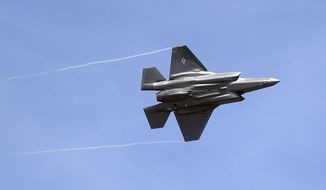 In this Sept. 2, 2015, photo, an F-35 jet arrives at its new operational base at Hill Air Force Base, in northern Utah. (AP Photo/Rick Bowmer, File)