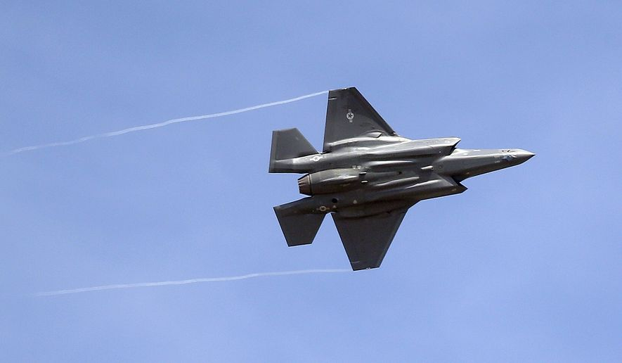 In this Sept. 2, 2015, file photo, an F-35 jet arrives at its new operational base at Hill Air Force Base, in northern Utah. (AP Photo/Rick Bowmer, File)