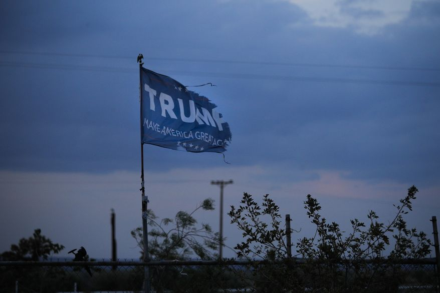 A withered Donald Trump campaign flag stands on a field Tuesday, May 1, 2018, in Maricopa, Calif. House Majority Leader Kevin McCarthy has often been underestimated, just like his hometown. Bakersfield is a stopover spot to fill up the tank outside of Los Angeles, full of oil drillers and farmers in a region that readily voted for President Trump. They call it the Texas of the West. (AP Photo/Jae C. Hong)