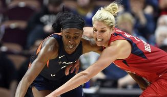 Connecticut Sun forward Chiney Ogwumike steals the ball from Washington Mystics forward Elena Delle Donne during the second half of a WNBA basketball game Wednesday, June 13, 2018, in Uncasville, Conn.. (Sean D. Elliot/The Day via AP) **FILE**